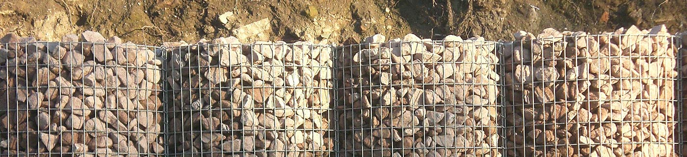 Filled gabion baskets